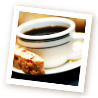 A Cup of Brewed Coffee with Biscotti